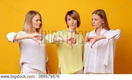 Disappointed Women. Dislike Gesture. Wrong Choice. Bad Idea. Group Portrait Of Three Dissatisfied La