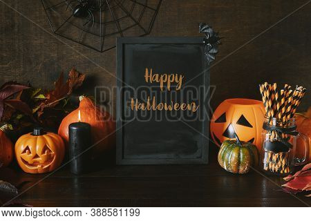 Halloween Party Background With Pumpkins, Web, Spooky Spiders, Pumpkin Head Jack-o-lantern On Dark.