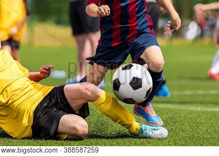 Soccer Football Tackle Moment. Skill Of Tackling In Soccer Game. Two Footballers In A Duel. Running