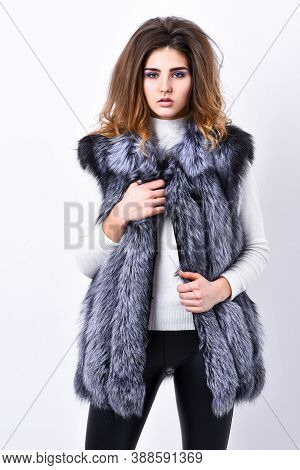 Girl Makeup Face Long Hairstyle Wear Fur Vest White Background. Luxury Fur Accessory. Fashion Trend