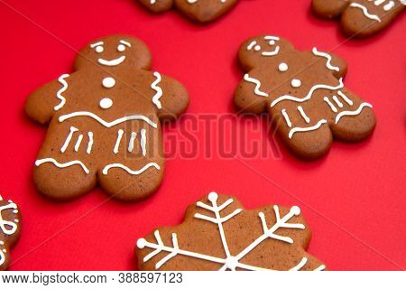 Tasty Homemade Christmas Gingerbread Cookies Of Various Shapes With Sugar Glaze On A Bright Festive