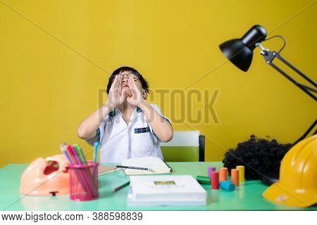 Young Students Make Funny Gestures, Learning Equipment On The Table.