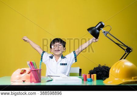 Happy Boy Doing Homework, Learning Equipment On The Table.