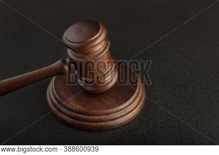 Gavel And Sounding Block On Black Background Close Up. Justice And Law Concept