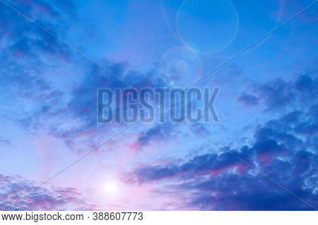Sunset dramatic sky background, colorful clouds lit by evening sunlight. Vast sky landscape panoramic scene, picturesque clouds in evening sky. Sky landscape, sunset sky background
