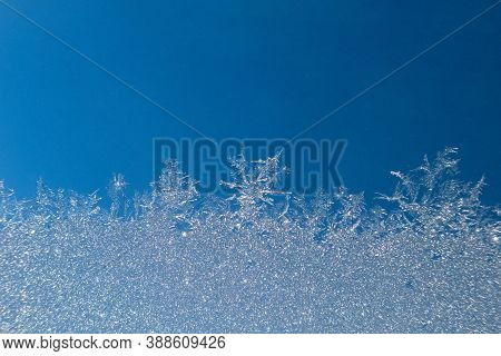 Abstract View Of Frost On Window Surface. Blue Crystal Frost Texture. Cold Winter Background. Nobody