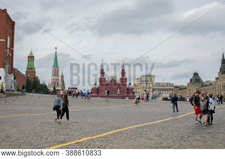 Moscow, Russia - August 24, 2020: Tourists Walking Along The Red Square. Historical Museum And Gum I