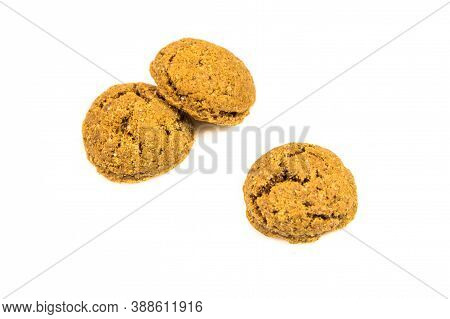 Set Of Three Pepernoten Cookies From Above On White Background For Annual Sinterklaas Holiday Event