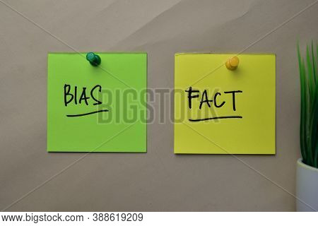Bias And Fact Write On Sticky Notes Isolated On Office Desk.
