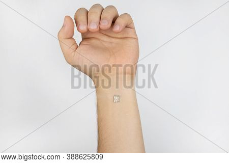 The Man Shows His Hand With A Chip Implanted. The Concept Of Chipping And Implantation Of Electronic