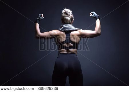 Blond Woman Muscular Back Fitness, Black Background