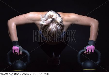 Fitness Woman Poses With Kettlebell , Black Background