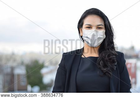 Portrait Of A Latina Businesswoman Outside Wearing A Mask During Covid-19 Global Pandemic