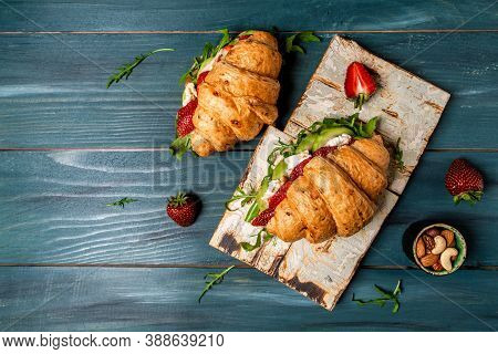 Breakfast, Business Lunch, Sandwiches Croissant With Strawberries And Soft Cheese With Mold Brie Cam