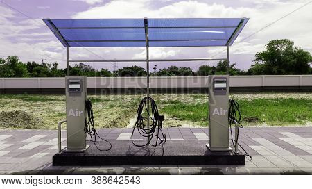 Tire Tire Inflator Station  With Bright Sky Clouds, Air Compressor Inflator Tank In Oil Pump