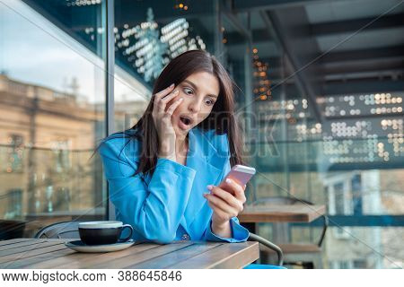 Sms. Closeup Portrait Funny Shocked Young Girl Looking At Phone Seeing Bad News Photos Message With