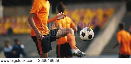 Soccer Player On Training With Ball. Young Football Athlete Kicking Ball. Soccer Tram Practice Sessi