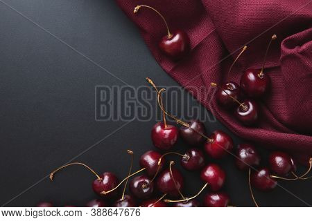 Cherry Background. Cherries On A Black Top View. Elegant Rich Cherry Background. Burgundy Background