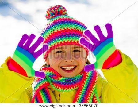 Winter fun, kid winter playing - lovely girl has a fun in snow