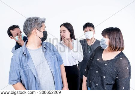 People Of Asian Wearing A Mask To Prevent Germs, Looking At Women Who Was Coughing And Sneezing With
