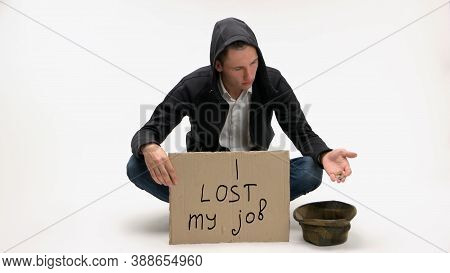Economical Financial Crisis Concept. Jobless Man With Cardboard Sign Dumps Coins Into Hat Isolated O