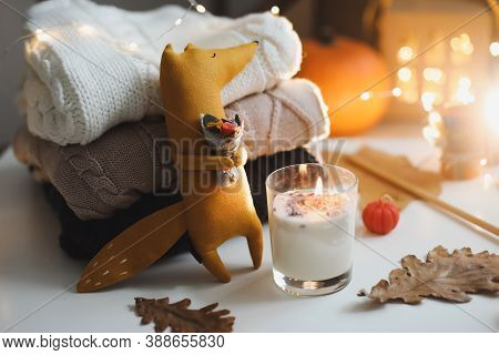 Autumn Cozy Still Life With Toy, Sweaters And Leaves. House Decor, Cozy Handmade Toys, Design Of Kid