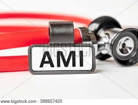 Ami Acute Myocardial Infarction Lettering On A Business Card With A Holder, Next To The Red Stethosc