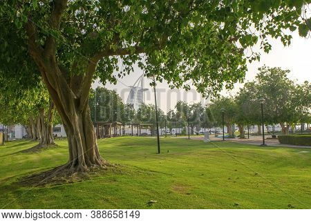 Dubai / Uae - July 3, 2020: View Of Beautiful Jumeirah Public Park With Burj Al Arab Hotel As A Back