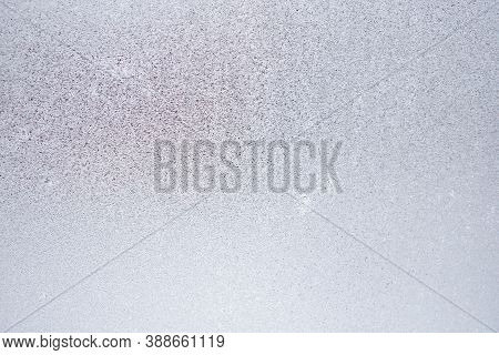 Ice And Frost On A Window Pane In Winter. Weather Forecast: Cold, Frost, Cooling. Abstract Light Bla