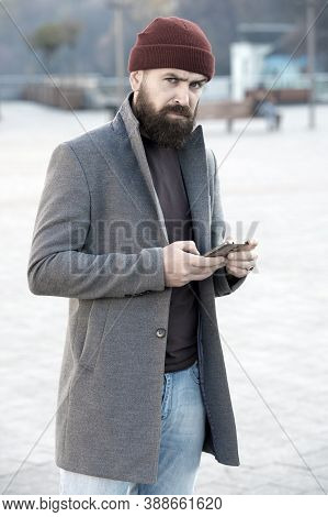 Menswear And Male Fashion Concept. Man Bearded Hipster Stylish Fashionable Coat And Hat. Stylish Mod