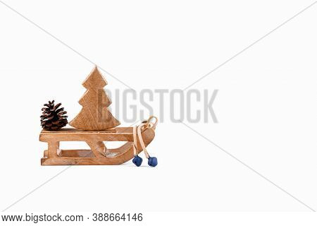 A Wooden Zero Waste Small Toy Sleigh With Wooden Christmas Tree, New Year Is Coming. Reusable Sustai