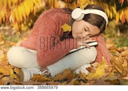 Absorbing Book While Sleeping. Little Child Fell Asleep Listening To Online Book. Small Girl Enjoy L