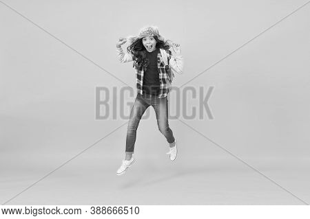 Jump Of Happiness. Active Girl Feel Happiness Yellow Background. Happy Child Enjoy Happiness And Fre