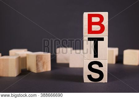 The Word Bts On Wooden Cubes, On A Black Background