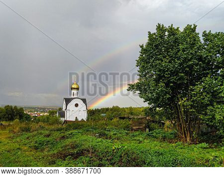 Landscape with the image of church and rainbow