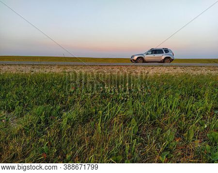 Briansk region, Russia - July, 20, 2020: Landscape with image of car on the countryside road