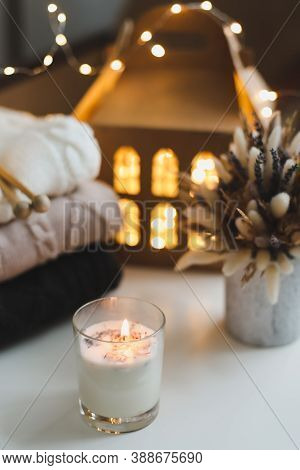 Christmas, Winter, New Year Background. Candle, Knitted Sweaters, Christmas Decorations Against Boke