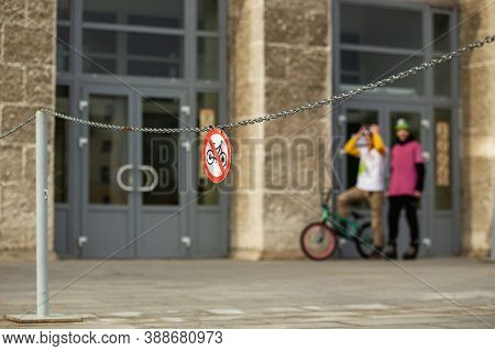 Red Bike Stop Sign On Street And Urban Extreme Bmx Bikerson The Background