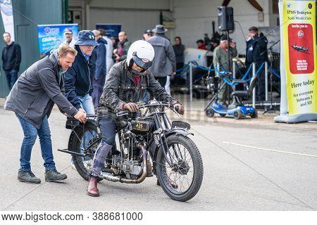 Old Warden, Bedfordshire, Uk, October 6, 2019.friends Help The Biker Start His Old Motorcycle Pushin