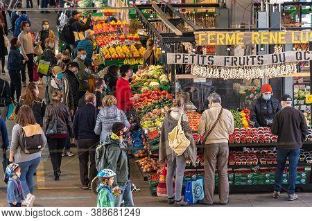 Montreal, Ca - 4 October 2020: Customers At Marche Jean Talon Market During Coronavirus Pandemy