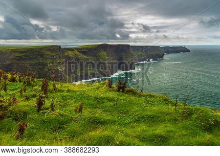 Aerial Panorama Of The Scenic Cliffs Of Moher In Ireland. This Popular Tourist Attraction Is Situate