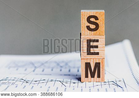 Word Sem - Search Engine Marketing - Acronym Concept On Cubes And Diagrams On A Gray Background