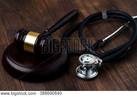 Judges Gavel And Stethoscope. Law And Medical Concept, Insurance Of Life, Gavel On A Brown Table And