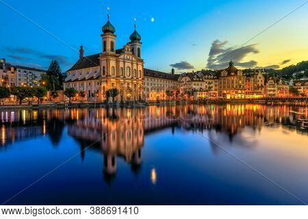 Blue Twilight On Lake Lucerne In Switzerland. Jesuitenkirche Church Of St. Francis Xavier Reflects O