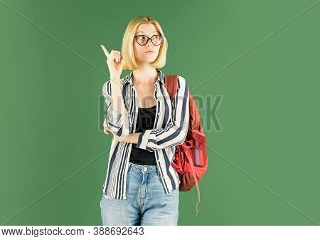 Young Woman On Green Blackboard Background - For Text Copy Space. Portrait Of College Student In Col