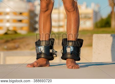 Man In Anti Gravity Or Inversion Boots For Upside Down Hanging. Sports Equipment. Boots Help To Redu