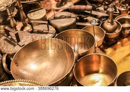 Set Of Thai Traditional Brass Cookware That Include A Small And Medium-sized Saucepan, A Large Sauce