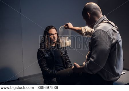 A Detained White Man With Long Hair Receives Irrefutable Evidence Of His Guilt From A Criminal Inves