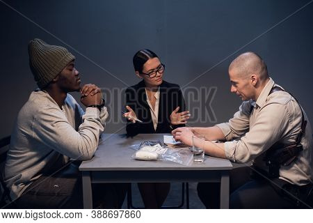 A Drug Dealer Detained With A Package Containing An Unknown White Substance Is Interrogated By An Ex