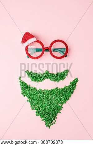 Santa Claus Minimal Concept. Christmas New Year Flat Lay. Funny Carnival Sun Glasses And Green Sweet